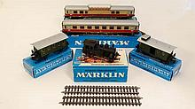 A collection of five blue boxed Marklin models comprising Luggage Van 4008, Passenger Coach 4007, Ta