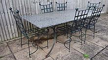 A 20 thC large garden table and chairs, the table with a one piece marble top and painted steel fram