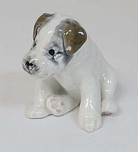 A Russian Konakova ceramic terrier puppy dog figurine, having factory stamps to base. 4 1/4'' high.