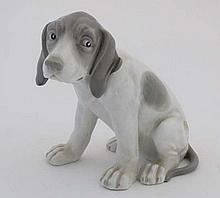 A late 19thh / early 20thC Gebruder Heubach hound figurine, having impressed mark and blue printed f