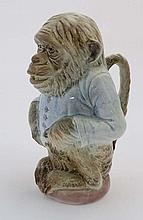 A 19thC French Saint Clement majolica jug / absinthe pitcher in the form of a chimpanzee monkey pitc