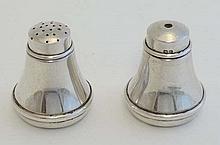 A HM silver salt and pepper cruet hallmarked Birmingham 1932 maker S J Levi & Co. each pot approx 1