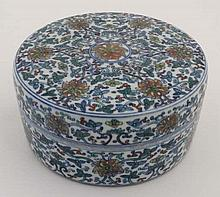 A Chinese circular lidded pot. Hand painted with floral and foliate details. Bearing  6 Chinese char