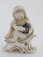 A Goebel putto porcelain figurine ,  number 12 004-12 , W. Germany 1977, having makers stamp to base