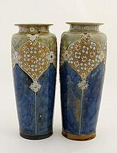 A Pair of Royal Doulton vases, number 8847, decorated with stylised flowers on a blue and green grou