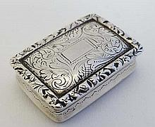 Nathaniel Mills : An early Victorian silver vinaigrette with acanthus scroll and floral decoration p