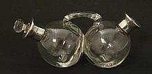 A twin glass oil and vinegar bottle with silver collars. Hallmarked 1935 with Jubilee mark. the whol