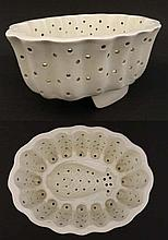 An unusual rare 19thC white ceramic, pierced jelly / curd mould with pineapple decoration and lobed
