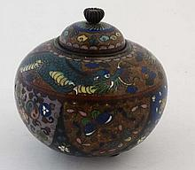 A 3-footed bellied pot and cover profusely decorated with  enamels with scrolling dragon to shoulder