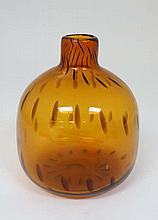 Scandinavian Retro Glass: A mid 20thC Skyrup , Sweden, amber studio art glass bottle vase, having or