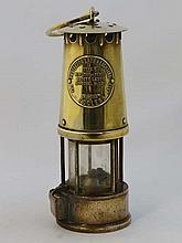 Davy lamp: An Eccles type 6 brass miners safety lamp ' Type 6, the Protector lamp and lighting compa