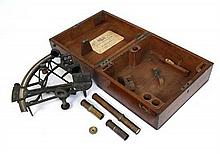 Henry Hughes & Son, Admiralty Instrument Makers : A labelled and mahogany boxed brass sextant. Scale