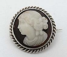A carved hardstone cameo brooch with white metal mount. Approx 1