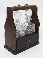 A late 20thC 2-bottle mahogany Tantalus with brass fittings, key lock and opening to reveal 2 square