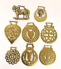 A collection of eight 19th and 20thC stamped heavy horse brasses, designs to include; working horse,