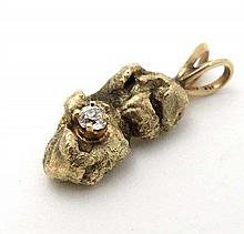 A pendant formed as a gold nugget set with diamond, the hanging loop marked 14k 1