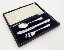 A cased Christening set comprising knife , fork and spoon hallmarked Sheffield 1920 maker James Deak