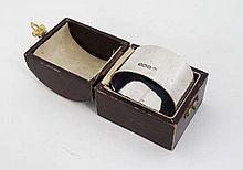 A cased silver napkin ring. Hallmarked Sheffield 1918 maker Thomas Bradbury & Sons Ltd (58g)