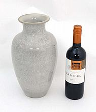 A large Oriental style crackle glazed vase. With grey background. 12'' high.