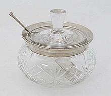 A cut glass preserve pot with silver rim hallmarked London 1928 maker Henry Perkins & Sons. With ass