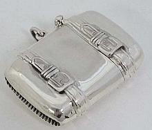 A modern novelty silver vesta formed  as a suitcase with hinged lid and striker under. 1 3/4