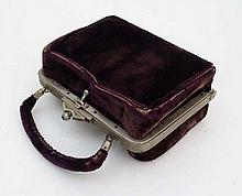 A  circa 1900 French velvet purse form necessaire set containing a silk lined interior with white me