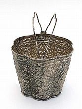 An oriental white metal ice bucket / ornamental pail with embossed acanthus scroll decoration and tw