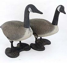 Decoys : A pair of cast and painted standing decoys formed as Canada Geese. 23 1/2