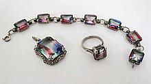 A suite of white metal jewellery set with Mystic Topaz comprising bracelet ring and pendant