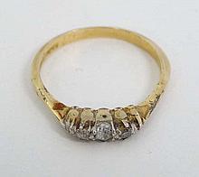 An 18ct gold ring set with 2 platinum diamonds