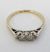 An 18ct gold ring set with three diamonds