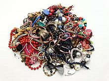 A large quantity of assorted costume jewellery including necklaces, bracelets etc