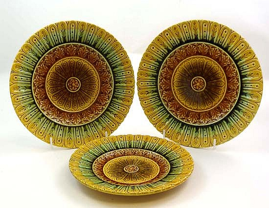 A set of 3 Continental plates glazed in ochre,