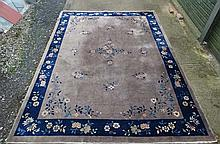 Rug / Carpet : A Chinese woollen carpet with floral decoration,  blue bande