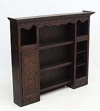 An 18thC and later carved oak narrow dresser plate rack. 50 1/2'' wide x 41