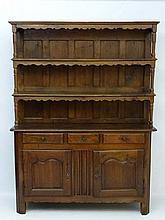 A late 19thC oak Continental dresser 63'' wide x 84'' high x 8 1/2'' deep