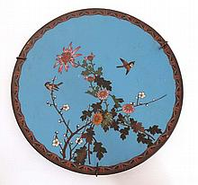 An Oriental Cloisonne charger depicting 2 sparrows amongst prunus and chrys