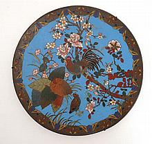 An Oriental Cloisonne charger depicting a cockerel amongst a flowering tree