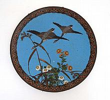 An Oriental Cloisonne charger depicting 2 Geese in flight . Approx 12'' dia