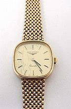 Longines : a 9ct gold cased ladies Wristwatch with H Marked gold strap and