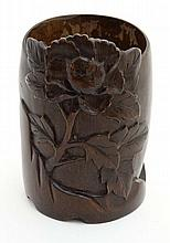 An Oriental carved bamboo pot with flowering peony decoration. 5 1/4'' high