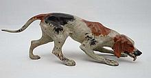 Dogs : a Cold Painted bronze of a tri coloured Hound sniffing scent, tongue
