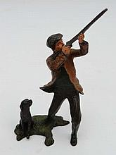 Shooting :  A cold painted bronze of a game shooter with his seated bla