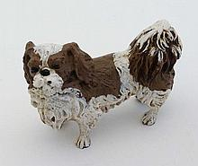 Cold Painted Bronze : a scale figure in liver and white of a Pekinese dog,