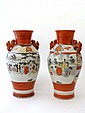 A Japanese porcelain pair of vases decorated with