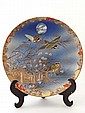 An Oriental plate decorated with 3 exotic birds in