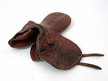 Saddle: an old leather jockey's racing saddle