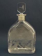 Fly Fishing: An Orrefors decanter with etched