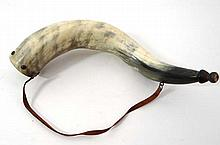 Muzzle loading : An ox horn powder flask, with