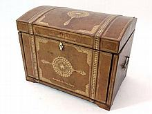 An unusual semi-domed gold tooled beige leather